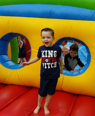 Child having fun on bouncy castle