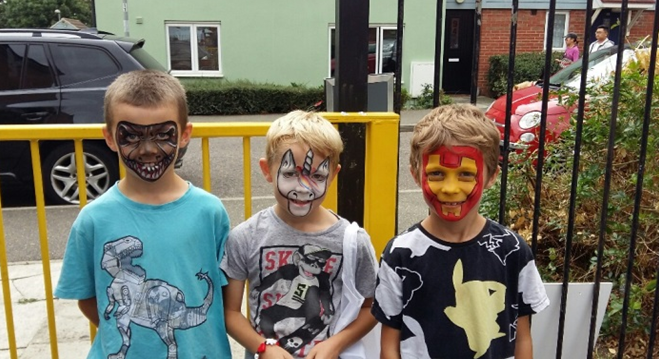 3 children having fun with face paint