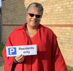 Glendale Road - Residents Parking Only - Janet Ledgerton, former chair of the Federation of Estuary Residents holding a Parking For Residents Only sign.