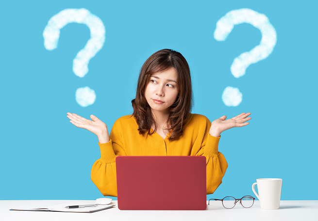 Confused Woman With Laptop And Question Marks
