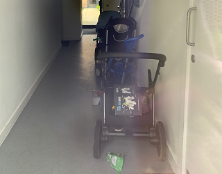 A buggy left in the communal area at Catlile House before its transformation