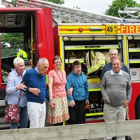Residents stanfding next to a fire engine