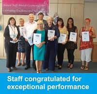 Photo of staff congratulated for exceptional performance
