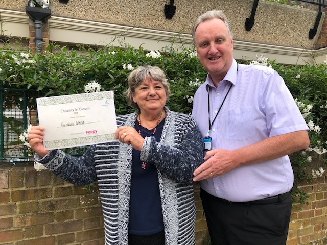 Christina White, winner of Estuary in Bloom 2018, presented with her prize by Kevin Turnpenney, Director of Housing and Communities.